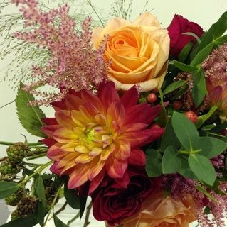 Sunset coloured dahlias and Tiffany roses!