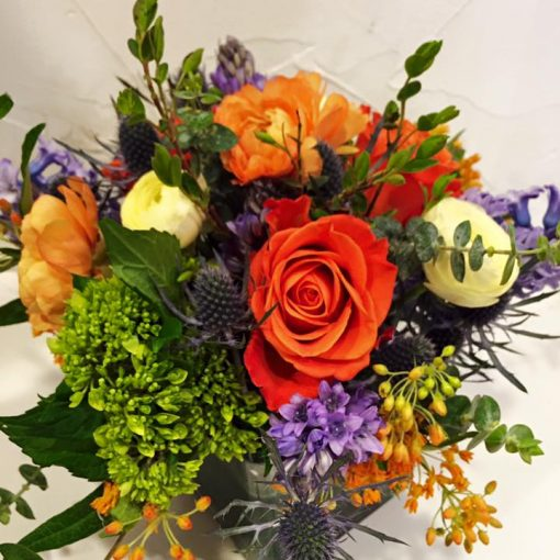 Purple, orange and green for a softer triadic mix.