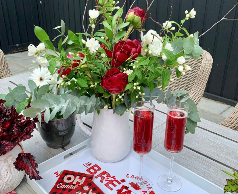 Canada Day Table with red and white flowers