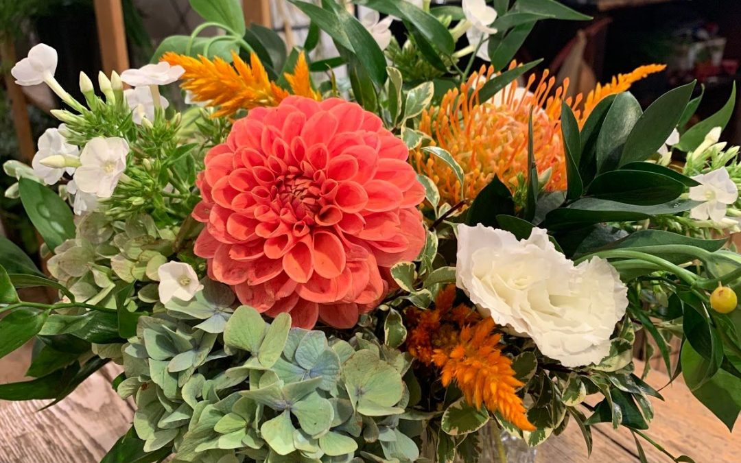 Rosh Hashanah floral arrangement with orange, peach, white and green tones