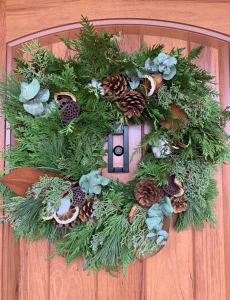 wreath with citrus, pinecones and greens