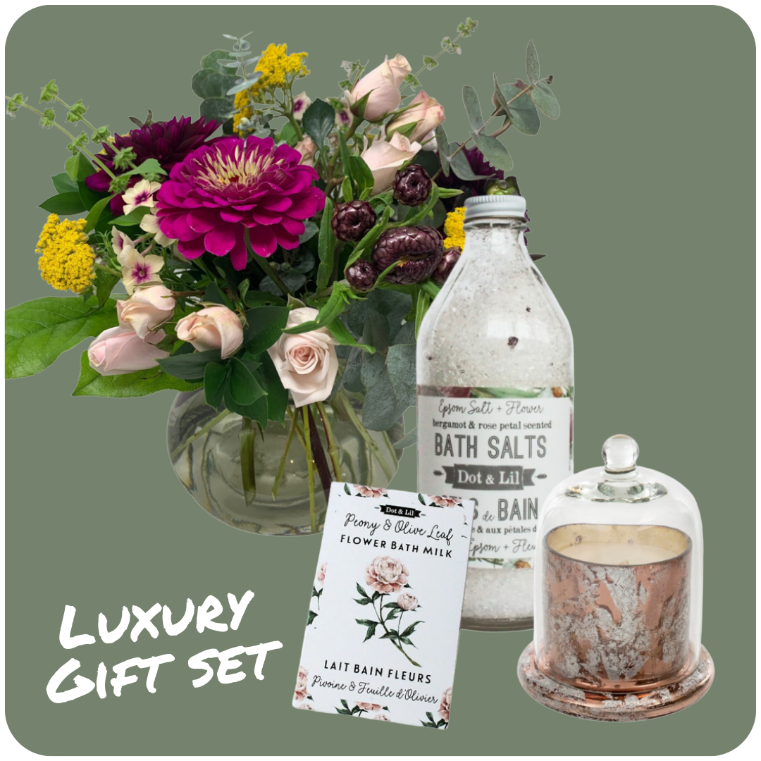 Image of a luxury gift set that includes flowers, a candle and bath products