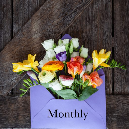 Flowers in an envelope representing a monthly floral subscription